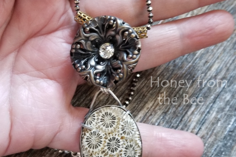 Bronze and sterling silver pendant