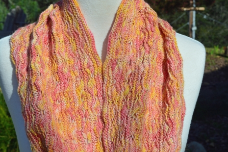 Yellow and pink knitted cowl