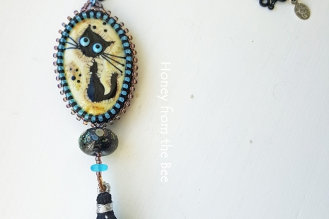 tunic length black cat pendant
