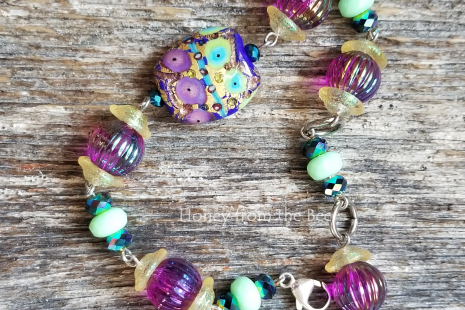 purple and green lampwork bracelet