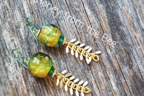 Green and gold artisan earrings