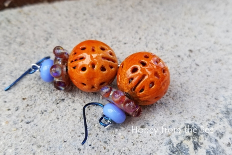 Orange enamel earrings