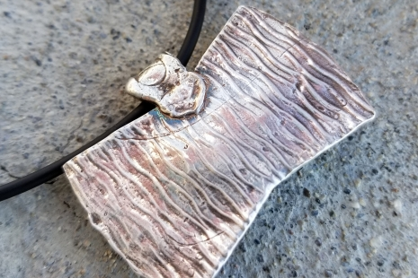 back of fine silver pendant