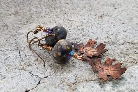 Raku lampwork and copper leaf earrings