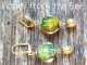 Gold and green lampwork earrings
