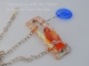 Orange lampwork fish and Mother of Pearl necklace