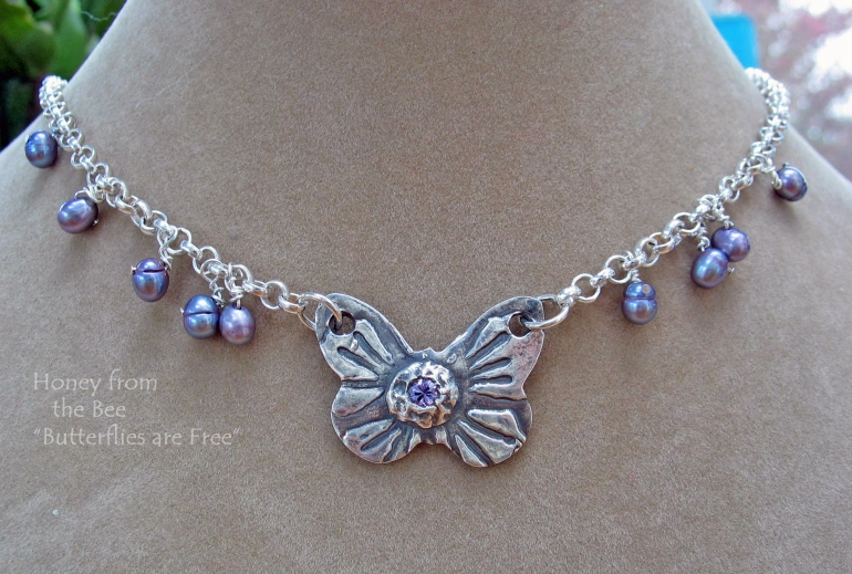 butterflies_are_free_-_fine_silver_butterfly_with_lavender_pearls_necklace.jpg