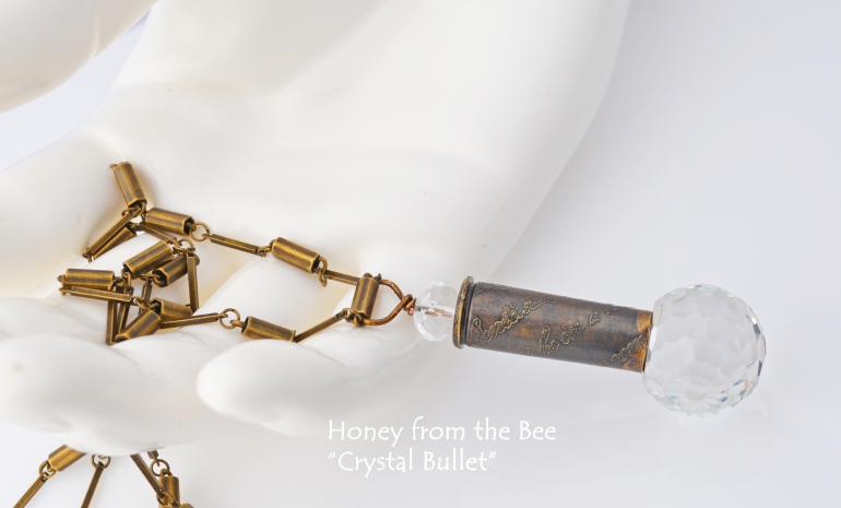 crystal_bullet_necklace_-_vintage_crystal_button_and_etched_bullet_pendant.jpg