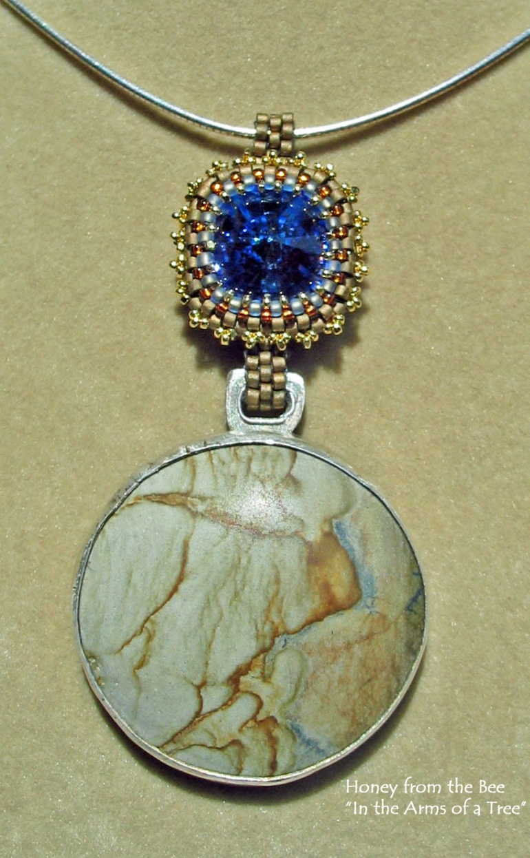 in_the_arms_of_a_tree_pendant_-_picture_jasper_swarovski_crystal_-_tan_and_blue_pendant.jpg