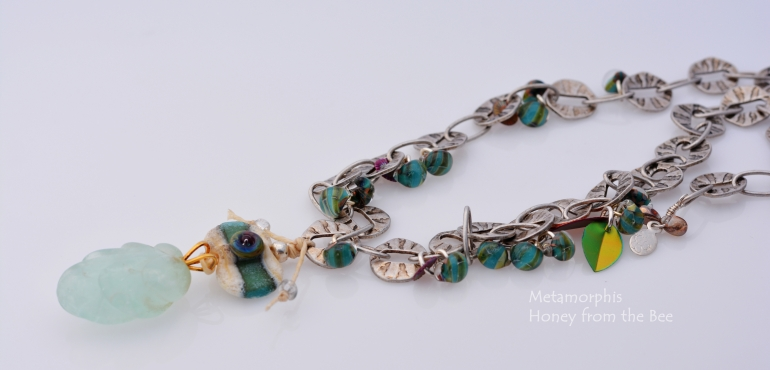 metamorphis_necklace_-_mixed_media_in_blue_green_glass_necklace.jpg