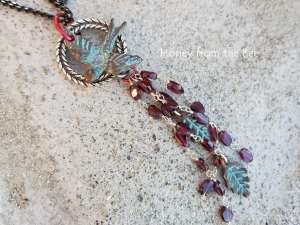 Artisan Pendant featuring Garnet, Sparrow, and leaf tassel