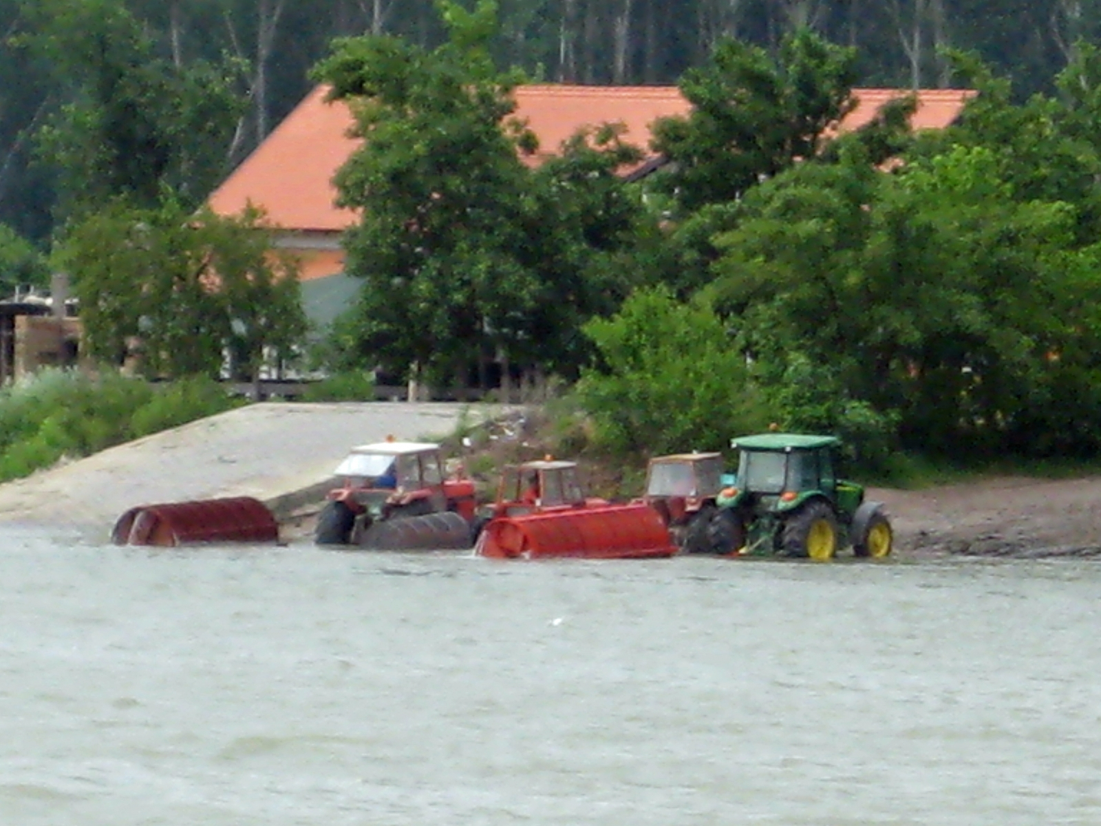 Rolling Barrels and Tractor on Danube