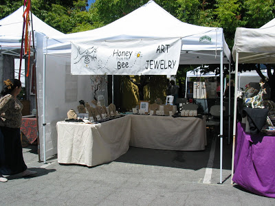 Honey from the Bee Artisan Jewelry show tent.