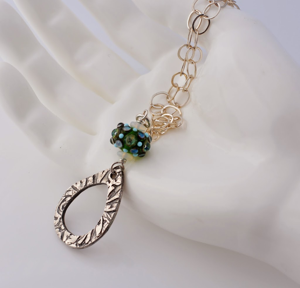 Silver and Green Lampwork pendant