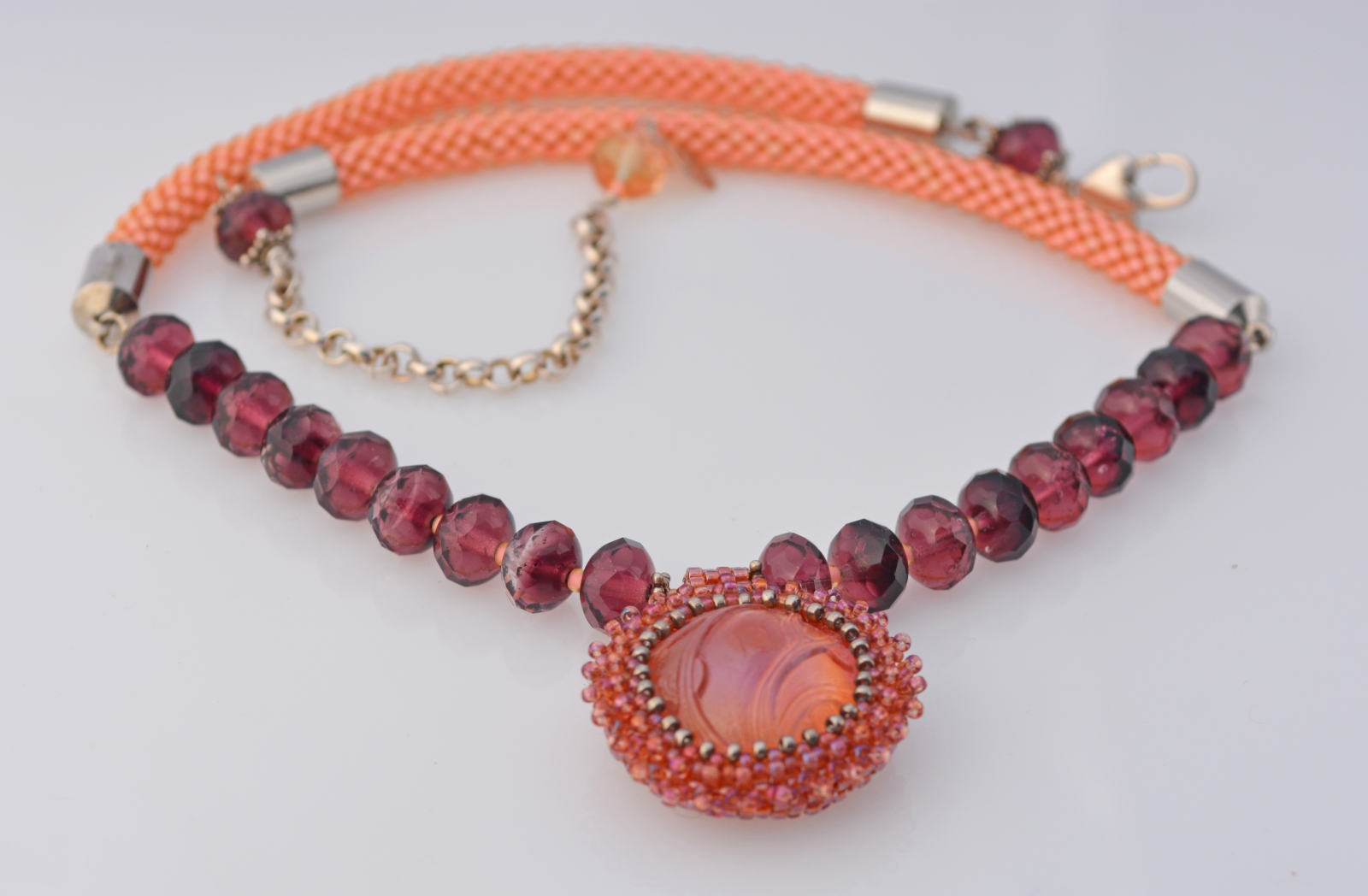 Artisan necklace in peach