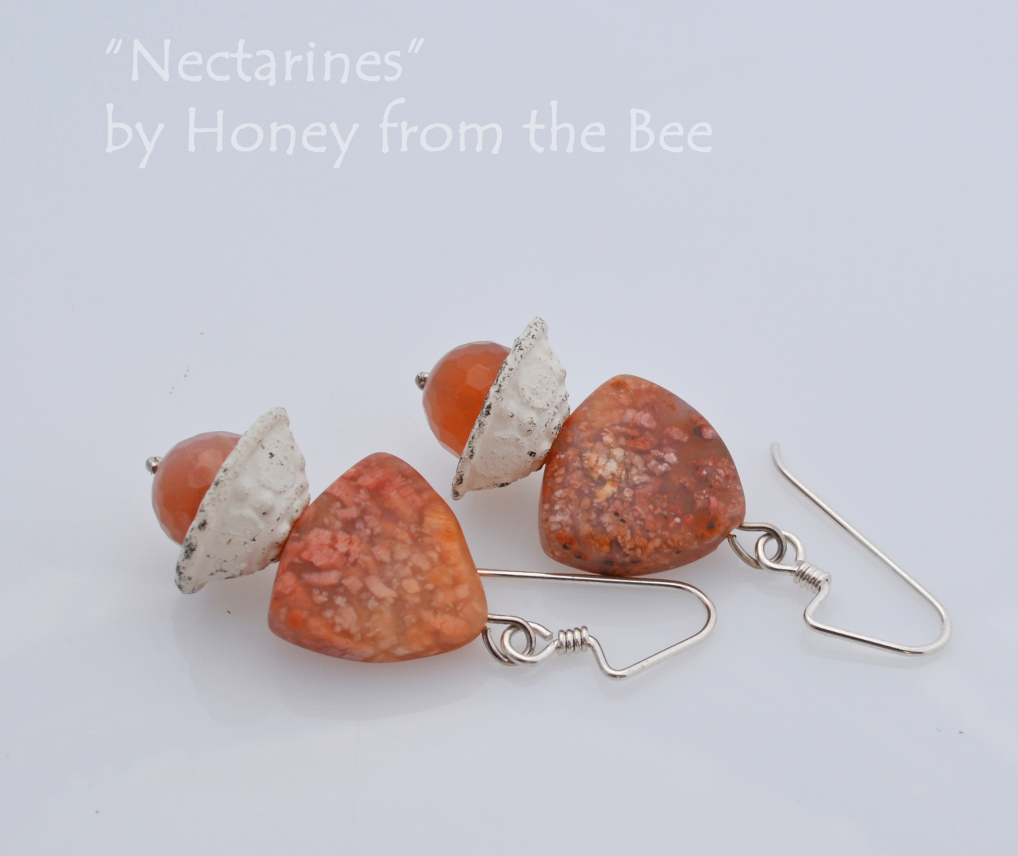 Artisan earrings in living coral