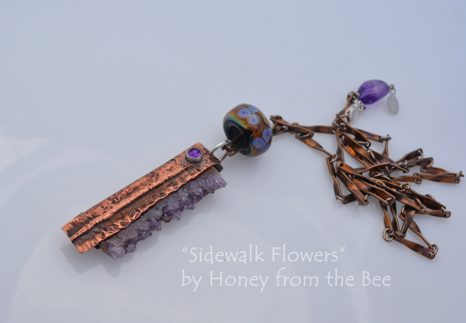 Amethyst and foldformed copper pendant by Honey from the Bee
