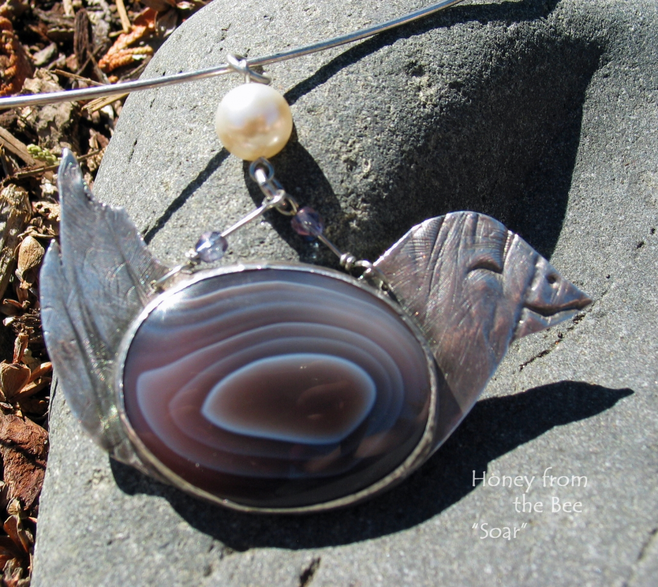 Botswana Agate and sterling silver bird pendant by Honey from the Bee
