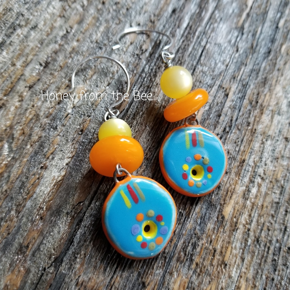 Bright orange and blue earrings
